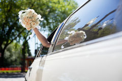 Bride waving hand holding bouquet Stock Photos