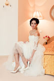 Bride is wear on her shoes Stock Photography