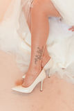 Bride is wear on her shoes Royalty Free Stock Photo