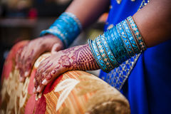 Bride wearing bangle bracelet Royalty Free Stock Photos