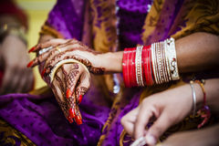 Bride wearing bangle bracelet Stock Photography