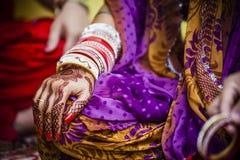 Bride wearing bangle bracelet Royalty Free Stock Image