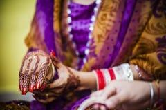 Bride wearing bangle bracelet Stock Photo