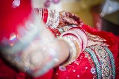 Bride wearing bangle bracelet Royalty Free Stock Photography