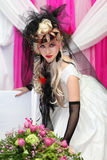 Bride wearing black net gloves and unusual hat Stock Image