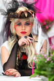 Bride wearing black net gloves and unusual hat Royalty Free Stock Photography