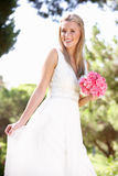 Bride Wearing Dress Holding Bouqet At Wedding Stock Image