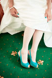 Bride wearing green wedding shoes Stock Photo