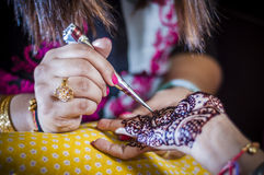 Bride wearing henna. Punjabi bride's hands, fully decorated with henna for her wedding day Stock Photos