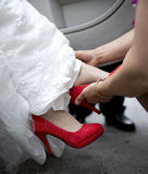 Bride wearing red shoes Stock Image
