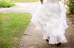 Bride wearing red shoes Stock Images