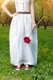 Bride wearing red sneakers outdoors Stock Images