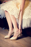 Bride wearing shoes Royalty Free Stock Photo