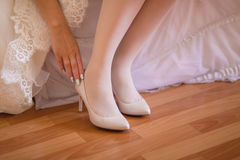 Bride wearing shoes Stock Photo