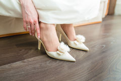 Bride wearing shoes Royalty Free Stock Images