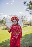 Bride wearing Vietnamese Ao Dai Stock Photography