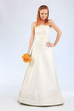 Bride wearing wedding dress Stock Image