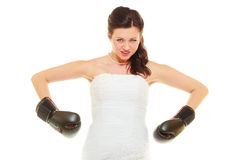 Bride wearing wedding dress and boxing gloves Royalty Free Stock Photography