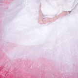 Bride wearing wedding dress waiting for groom on the bed Royalty Free Stock Photos