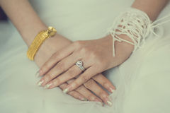 The bride wearing a wedding ring Stock Photography