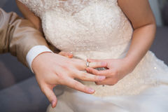 Bride wearing a wedding ring for her groom Royalty Free Stock Photography
