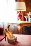 Bride wearing wedding shoes Stock Photography
