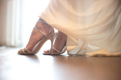 Bride wearing wedding shoes. Close-up details of brides feet wearing shoes.  Royalty Free Stock Image