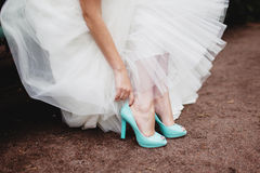 Bride wearing wedding shoes. Bride wearing mint wedding shoes Stock Photography