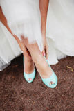 Bride wearing wedding shoes. Bride wearing mint wedding shoes Stock Images