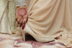 A bride wearing wedding shoes. Wedding, shoes, solemnization, beautiful, henna Royalty Free Stock Photos
