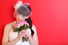 Bride wearing white dress holds bouquet royalty free stock image