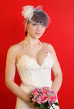 Bride wearing white dress holds bouquet of roses stock images