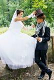 Bride wears a cowboy hat Stock Images