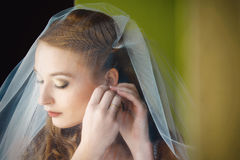The bride wears jewelry woman Stock Images