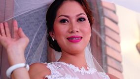 Bride wears veil poses for picture. Close up stock video footage