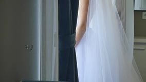 Bride Wears a Wedding Dress in Hotel Room.  stock footage