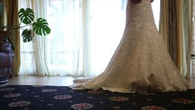 Bride wears a wedding dress in the morning. Bride in the room. Close up. The bride wears a wedding dress in the morning, morning of the wedding day, the bride stock footage