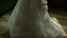 The bride wears a wedding dress in the morning. Sequence. 2 shot stock video footage
