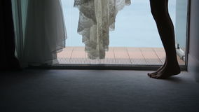 The bride wears a wedding dress in the morning. Sequence 2 shot stock video footage
