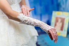 Bride wears wedding gloves Stock Image