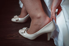 The bride wears shoes Royalty Free Stock Photo