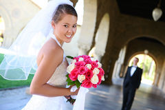 Bride at Wedding. A beautiful woman bride at church during wedding with groom in the background stock photos