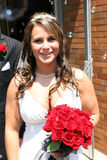 Bride After Wedding. Smiling with red roses Stock Images