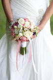 Bride with a wedding bouquet. The bride with a wedding bouquet Stock Photo