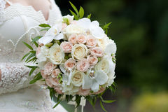Bride with a wedding bouquet. The bride with a wedding bouquet Stock Photography