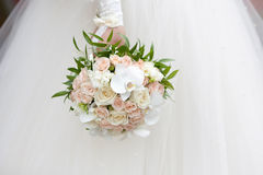Bride with a wedding bouquet. The bride with a wedding bouquet Stock Images