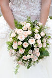 Bride with a wedding bouquet. The bride with a wedding bouquet Stock Image