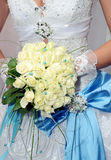 Bride and wedding bouquet Stock Photography