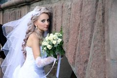 Bride with  wedding bouquet. Royalty Free Stock Images