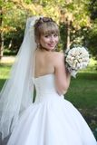 Bride with  wedding bouquet. In park Royalty Free Stock Images